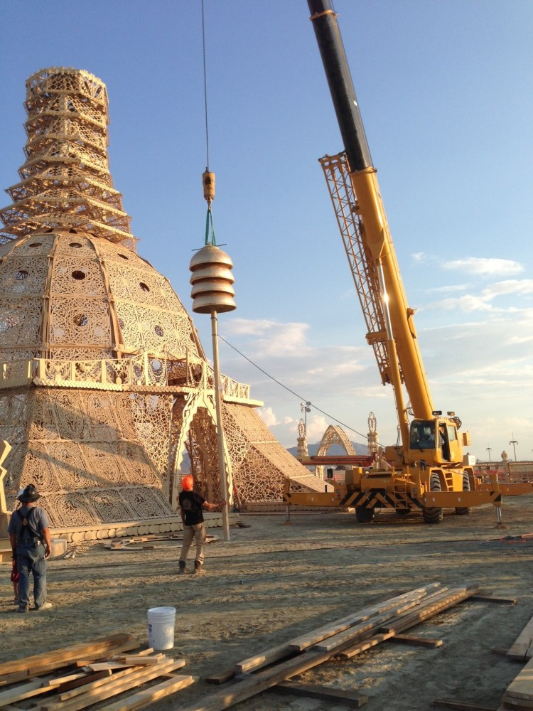 DOMES BEING LIFTED BY CRANE