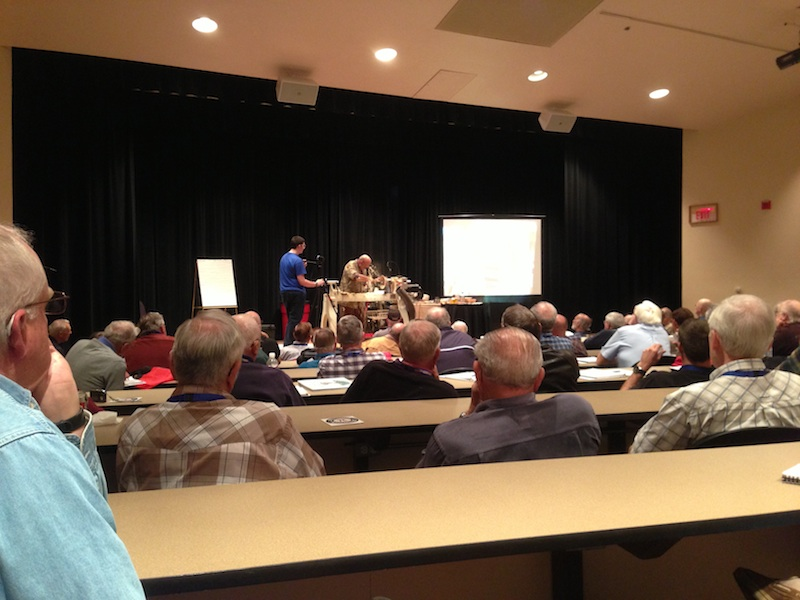 Richard Raffan on stage turning a bowl for the Desert Woodturning Roundup