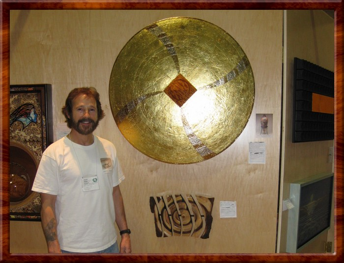 David next to Gold Fusion Wall sculpture