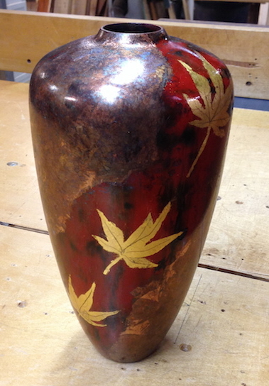 Student brought a vessel to the class and applied metal leaf followed with chemicals to create a patina.
